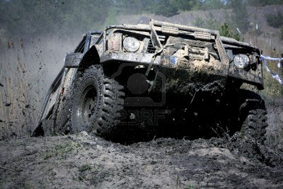 2666439-extreme-off-road-the-vehicle-jumping-and-splashing-out-the-mud